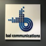 BAI Communications' logo inside the Toronto-based office.